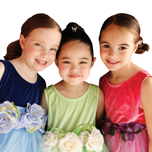 Three girls dressed up in fancy dresses for a Snip-its glam party.