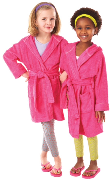 Two girls wearing matching pink robes for a spa day at Snip-its.
