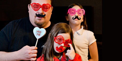A family wearing fun Valentine's Day decorations.